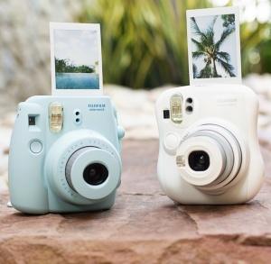 http://photojojo.com/store/awesomeness/instax-camera